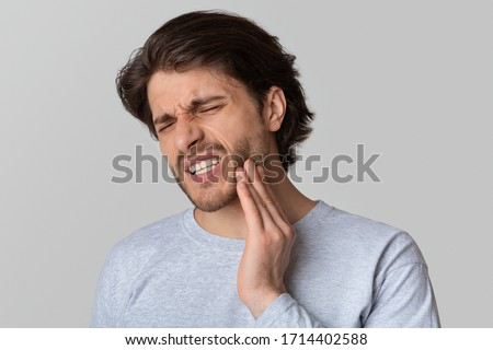 Dental problems concept. Man suffering from bad toothache, empty space #1714402588