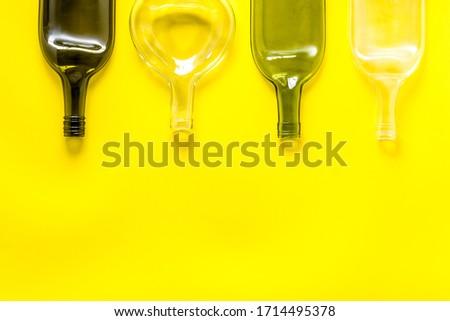 Flat lay with bottles on yellow table top-down copy space #1714495378