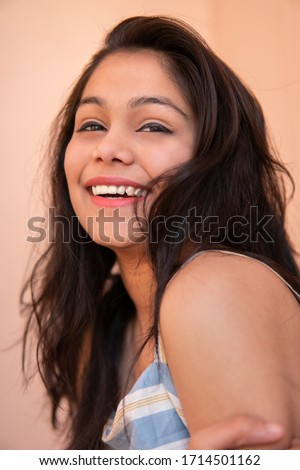Close-up Portrait of beautiful happy late teen girl looking at camera with toothy smile. #1714501162