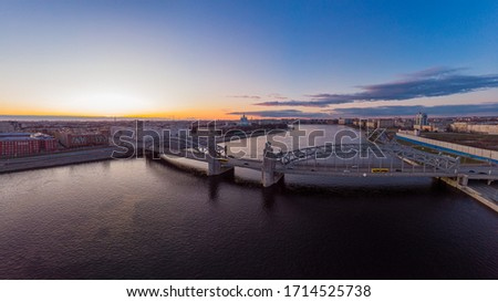 St. Petersburg Russia. Aerial panoramic view from drone to Peter the Great bridge of white nights. Bolsheokhtinsky bridge across the river Neva with evening lighting city with driving cars on highway. #1714525738