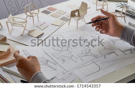 Designer sketching drawing design development product plan draft chair armchair Wingback Interior furniture prototype manufacturing production. designer studio concept .                            Royalty-Free Stock Photo #1714543357