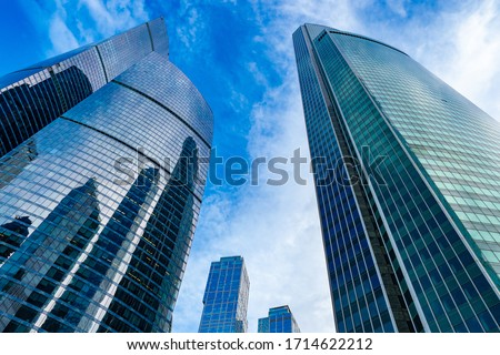 Moskva-city. Bottom view of the skyscrapers in the center of the Russian capital. Business center of Moscow. Office rental. Office real estate. High-rise buildings against the blue sky. #1714622212