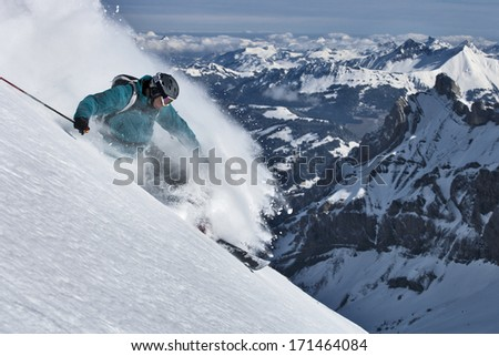 Free ride skier turns in powder snow. #171464084