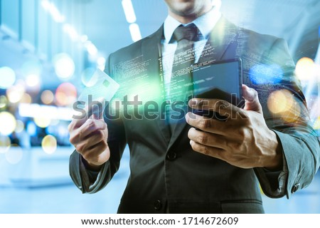 Success businessman with hi-tech smart gadget technology iOT internet of things, business investment graph chart 3D futuristic virtual office blur background, finance business report data manage #1714672609