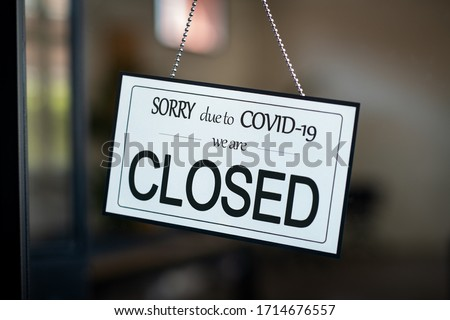 Shop closed due to Covid-19 outbreak lockdown. Temporarily closed sign for coronavirus in a small business activity due to quarantine measures in public places and restaurant. We are closed sign board #1714676557