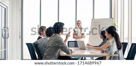 Woman leader working brainstorm to solve problem with team, presentation new idea. People discuss and smile on new challenge topic in meeting room. Business finance and communication planning concept. #1714689967