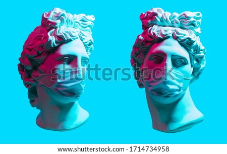 Creative concept of neon. Apollo statue In Medical Mask #1714734958