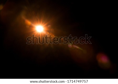 Abstract Natural Sun flare on the black Royalty-Free Stock Photo #1714749757