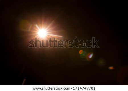 Abstract Natural Sun flare on the black #1714749781