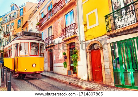 Yellow vintage tram on the street in Lisbon, Portugal. Famous travel destination #1714807885