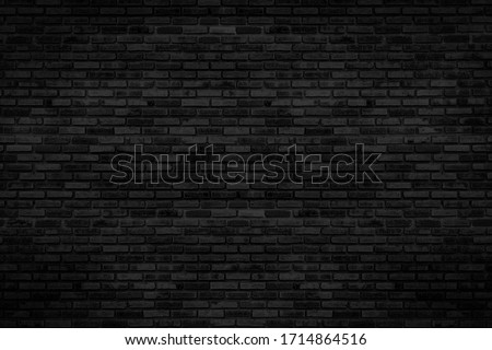 Black brick walls that are not plastered background and texture. The texture of the brick is black. Background of empty brick basement wall. #1714864516