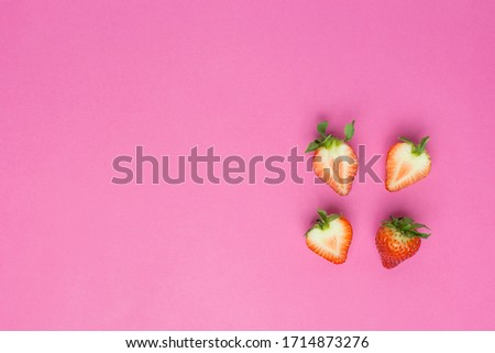 Strawberries isolated on pink background. Fresh berry flat lay. Creative Minimal food concept. Copy space, whole berries and halves #1714873276