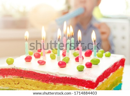 Birthday cake with candles. Happy birthday. Colored candles burn