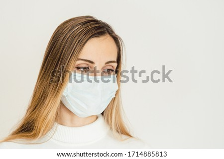 Woman contemplating what lies ahead during Coronavirus crisis being worried #1714885813