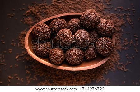 Chocolate Easter Egg filled with brigadeiro (brigadier), Goumert egg chocolate tradition in Brazil.  Royalty-Free Stock Photo #1714976722