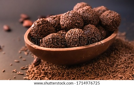 Chocolate Easter Egg filled with brigadeiro (brigadier), Goumert egg chocolate tradition in Brazil.  Royalty-Free Stock Photo #1714976725