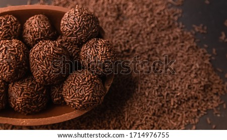 Chocolate Easter Egg filled with brigadeiro (brigadier), Goumert egg chocolate tradition in Brazil.  Royalty-Free Stock Photo #1714976755
