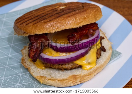 Close up picture of a tasty bacon cheese hamburger