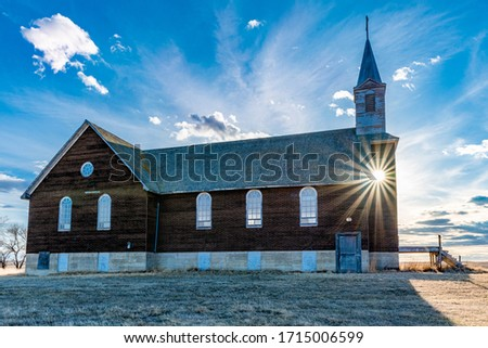 Sunset over St. Joseph Parish Catholic Church in Frenchville, Saskatchewan #1715006599