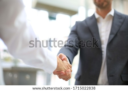 Business partnership handshake concept.Photo two coworkers handshaking process.Successful deal after a great meeting. #1715022838