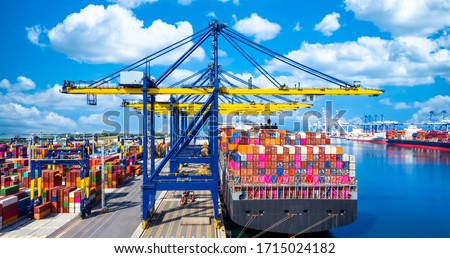Container ship at industrial port in import export global business worldwide logistic and transportation, Container ship unloading freight shipping, Container cargo industry vessel boat freight. Royalty-Free Stock Photo #1715024182