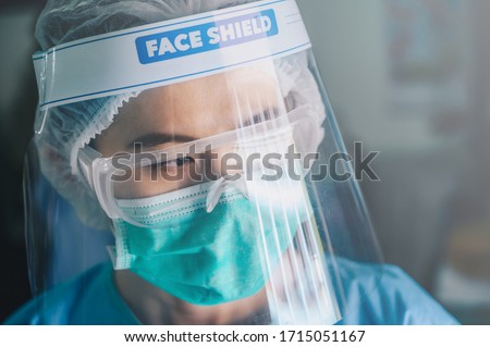 Nurse having tired from work while wearing PPE suit for protect coronavirus disease. PPE while protecting healthcare workers from exposure to the COVID-19 virus in healthcare settings. #1715051167
