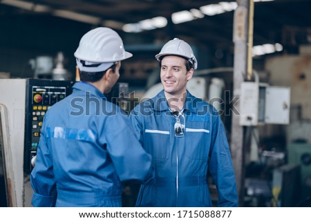 professional technician engineer and mentor shake hand in factory Royalty-Free Stock Photo #1715088877