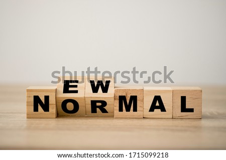 Hand flipping wooden block cubes for new normal wording. The world is changing to balance it into new normal include business , economy , environment and health. #1715099218