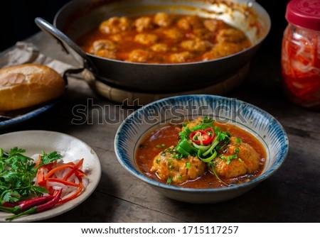 vietnamese meatball with tomato sauce - vietnamese food Royalty-Free Stock Photo #1715117257