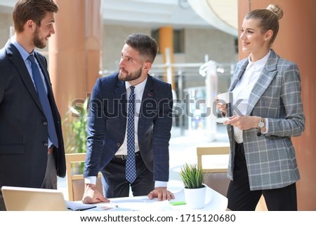 Group of business partners discussing ideas and planning work in office. #1715120680