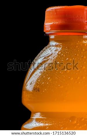 Closeup on lightning bolt on an orange power drink bottle.