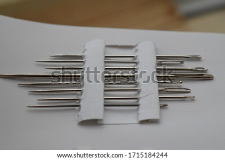 A set of sewing needles on a white background. #1715184244