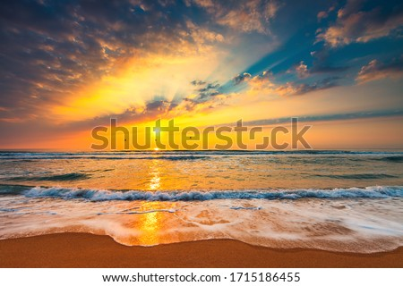 Beach sunrise over the tropical sea Royalty-Free Stock Photo #1715186455