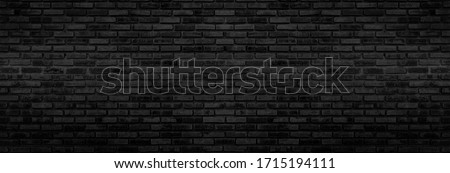 Panorama Black brick walls that are not plastered background and texture. The texture of the brick is black. Background of empty brick basement wall. #1715194111