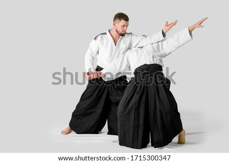 Two caucasian men are practicing aikido on the tatami (isolation path included) Royalty-Free Stock Photo #1715300347