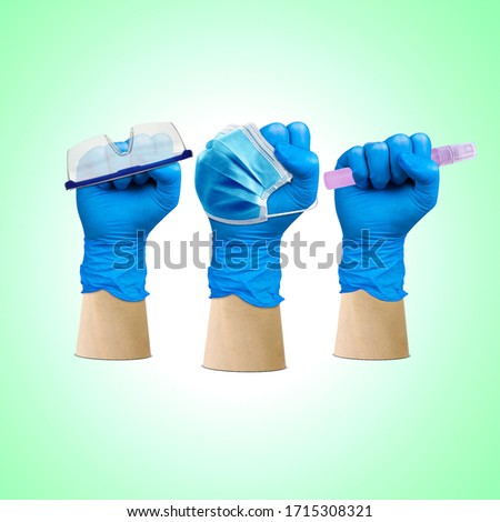 Labor Day, hand fist wear medical gloves hold on protection glass and hand sanitizer, Medical Team Doctor Group Labor Day, Doctor Labor Day, Doctor May day, Medical Hero,1 May Holiday, Corona Royalty-Free Stock Photo #1715308321