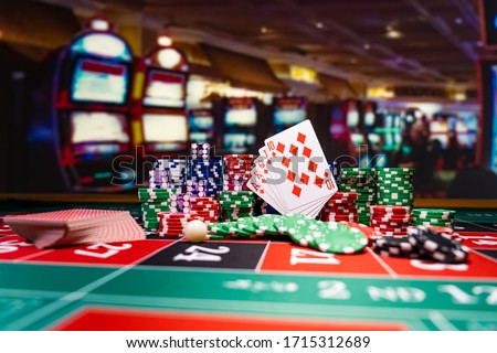 Casino set with Roulette, cards, dice and chips on BlackJack mat #1715312689