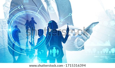 Businessman with smartphone and his team working in city with double exposure of online work interface. Toned image. Elements of this image furnished by NASA #1715316394
