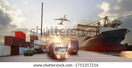Container truck in ship port for business Logistics and transportation of Container Cargo ship and Cargo plane with working crane bridge in shipyard at sunrise, logistic import export and transport  Royalty-Free Stock Photo #1715317216