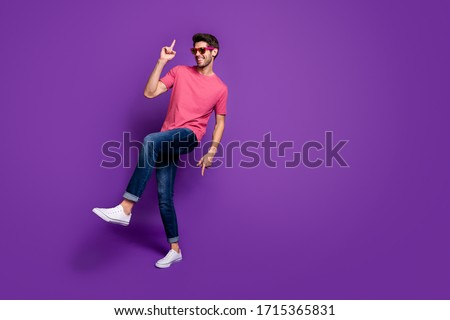 Full length photo of positive cheerful cool energetic guy music lover enjoy dance hip hop night club wear trendy clothes sneakers isolated over violet bright color background Royalty-Free Stock Photo #1715365831