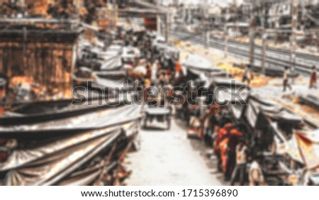 Bazar =-- Blurry view of an Indian market in footpath.