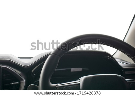 Closeup of  steering wheel car interior luxury black, dashboard, climate control, speedometer, isolated on white for content or advertisement graphic design background. Royalty-Free Stock Photo #1715428378