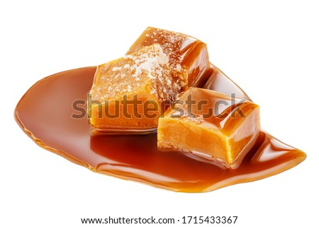 Soft melted caramel isolated on a white background. Salted toffee candies with caramel sauce #1715433367
