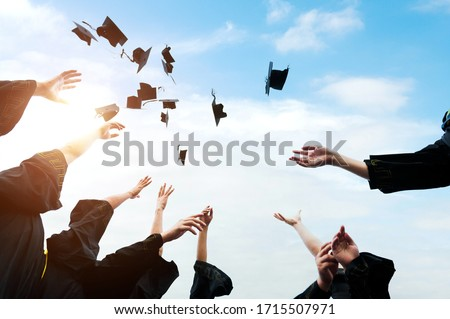 Graduating students hands throwing graduation caps in the air. #1715507971