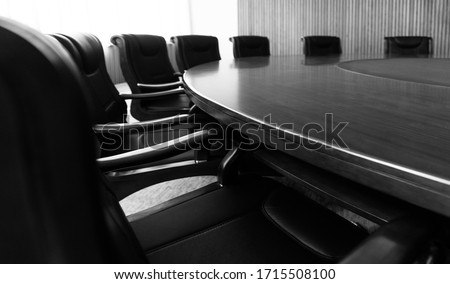 Conference table and chairs in modern meeting room. Royalty-Free Stock Photo #1715508100