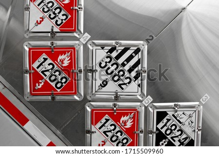 Abstract View of DOT Placards Displayed on the Rear of a Fuel Tanker