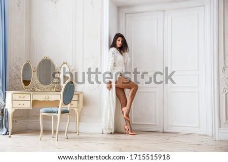 Beautiful girl sexy brunette in underwear posing in a room interior #1715515918