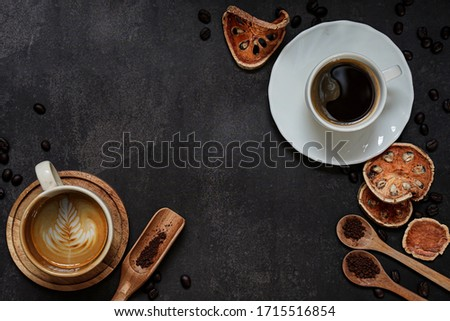 Cup of coffee on black background. Copy space. Top view. Flat lay. copy space.