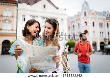 Happy friends enjoying sightseeing tour in the city. Royalty-Free Stock Photo #1715522242