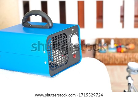 generator converter disinfectant ozone inside a home. covid 19 Royalty-Free Stock Photo #1715529724